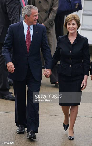 President George W Bush and his wife First Lady Laura make their way across the tarmac to their helicopter after arriving for the G8 summit on June 5...
