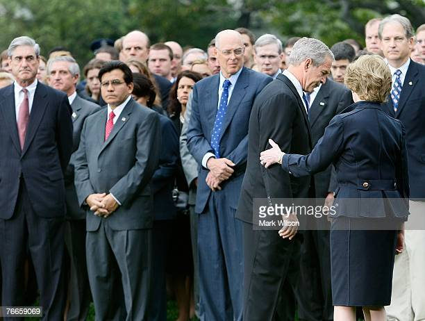 S President George W Bush and his wife Laura Bush walk away during in a ceremony to honor the victims of the 911 terror attacks while FBI director...