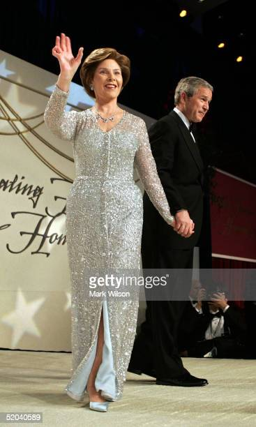 President George W. Bush and his wife Laura walk onto the stage at the Stars And Stripes Ball January 20, 2005 in Washington, DC. Bush was...