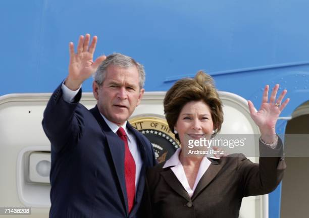 President George W Bush and his wife Laura wave goodbye as they enter Air Force One on July 14 2006 in Rostock Germany Bush continues to the G8...