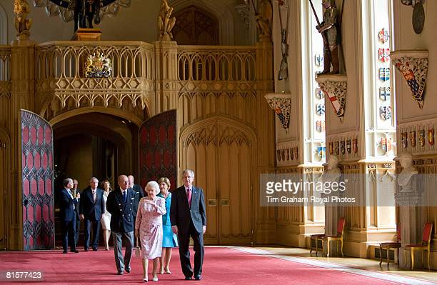 President George W Bush and his wife the First Lady Laura Bush meet with Queen Elizabeth II and Prince Philip Duke of Edinburgh and walk through St...