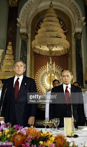 President George W Bush and HM King Bhumipol Adulyadej stand as they listen to their respective national anthems during the state dinner ceremonies...