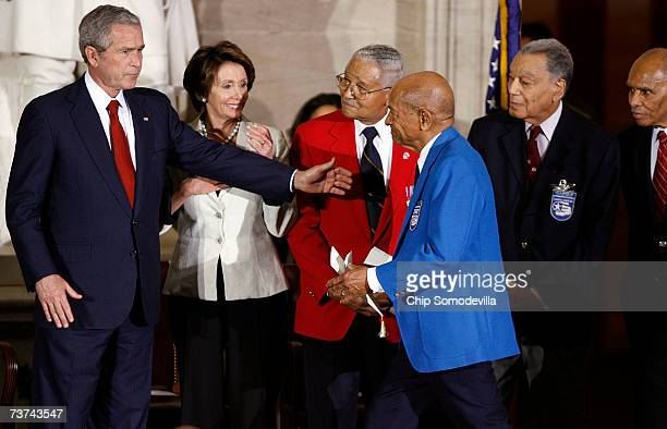 President George W Bush and House Speaker Nancy Pelosi and Tuskegee Airmen Col Charles McGee Col Harry Stewart Col Lee Archer and Dr Roscoe Brown...