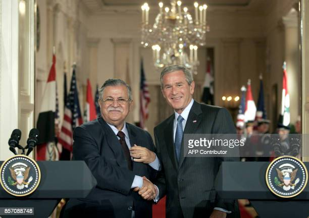 US President George W Bush and Iraqi President Jalal Talabani shake hands following a brief press conference in the East Room of the White House in...