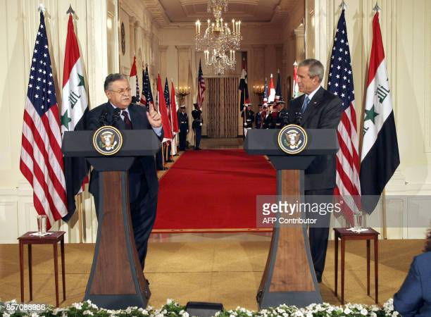 US President George W Bush and Iraqi President Jalal Talabani take part in a brief press conference in the East Room of the White House in Washington...