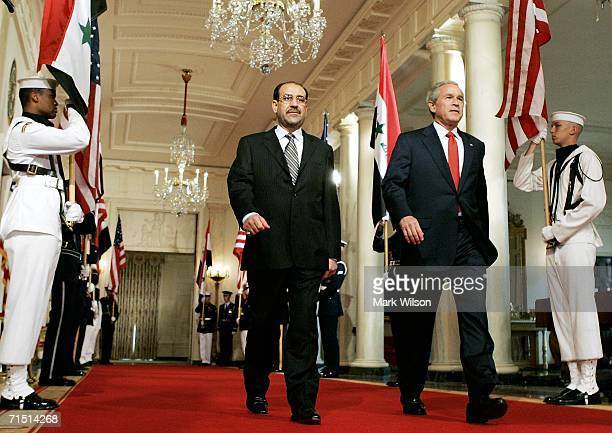 S President George W Bush and Iraqi Prime Minister Nouri alMaliki walk up to the podium before speaking in the East Room of the White House July 25...