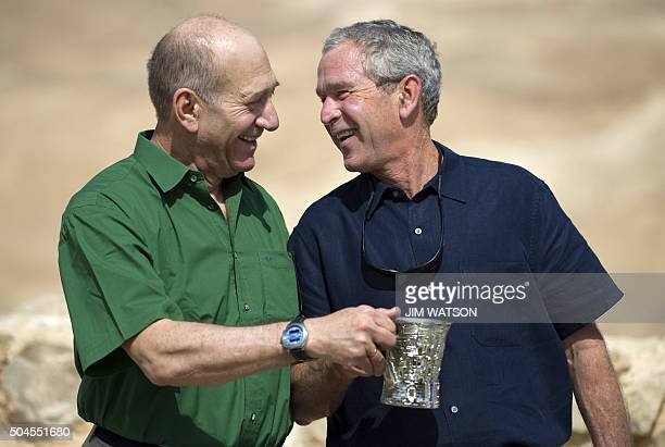 US President George W Bush and Israeli Prime Minister Ehud Olmert laugh during a tour to the ancient hilltop fortress of Masada on May 15 2008 in the...