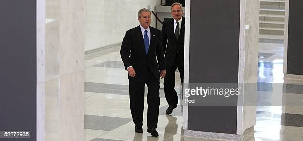 President George W Bush and J Porter Goss director of the CIA walk through the foyer of the agency's headquarters after Bush met with workers March 3...