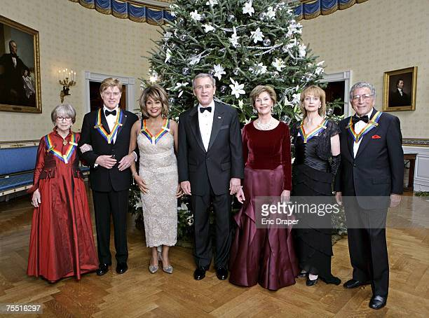 President George W Bush and Laura Bush pose with the Kennedy Center honorees from left to right actress Julie Harris actor Robert Redford singer Tina...