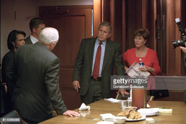 President George W Bush and Mrs Laura Bush talk with Vice President Dick Cheney and National Security Adviser Condoleezza Rice Tuesday September 11...