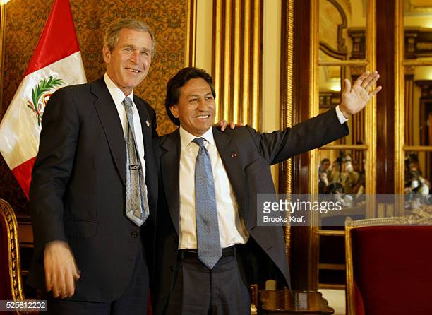President George W Bush and Peruvian president Alejandro Toledo stand for a photo op at the Presidential Palace in Lima Bush is meeting with Toledo...