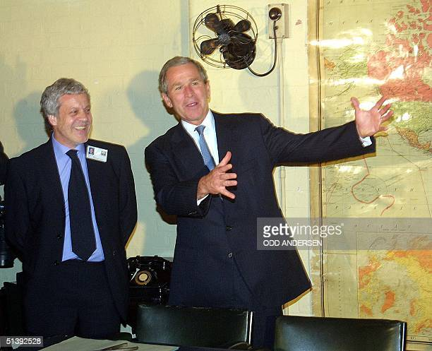 President George W. Bush and Philip Reed , Curator of the Winston Churchill's Cabinet War Rooms in London, shares a laugh 19 July 2001 as they visit...