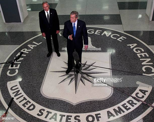 President George W Bush and Porter Goss director of the Central Intelligence Agency left answer questions from the media after President Bush met...
