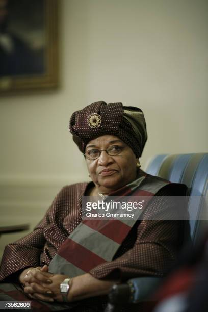President George W Bush and President of Liberia Ellen JohnsonSirleaf speak to the press in the Oval Office of the White House in Washington DC 14...