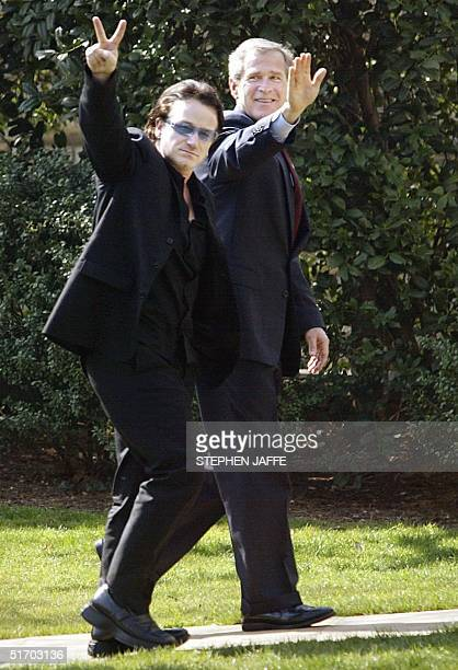 President George W Bush and rock star Bono lead singer of U2 walk to the Oval Office of the White House after attending an event together 14 March...