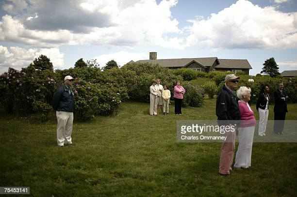 President George W Bush and Russian President Vladamir Putin hold a joint press conference outside the main house at the Bush family house at...