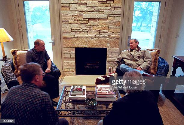 President George W Bush and Russian President Vladimir Putin begin their first meeting inside a guest room of the Bush Ranch November 14 2001 in...