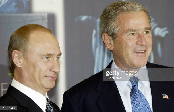 President George W. Bush and Russian President Vladimir Putin participate in a bilateral meeting before the opening session of the annual APEC...