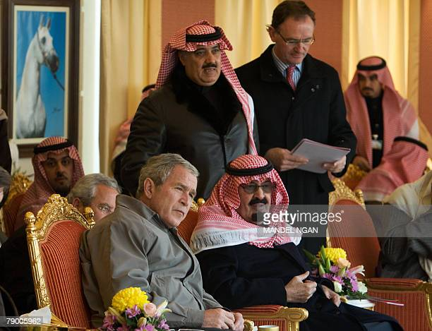 US President George W Bush and Saudi King Abdullah bin Abdul Aziz alSaud view the King's horses 15 January 2008 at the monarch's ranch in...