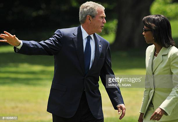 President George W. Bush and Secretary of State Condoleezza Rice walk across the South Lawn June 08, 2008 upon return to the White House in...
