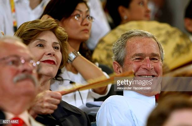 President George W Bush and US First Lady Laura Bush watch the Opening Ceremony for the 2008 Beijing Summer Olympics at the National Stadium on...