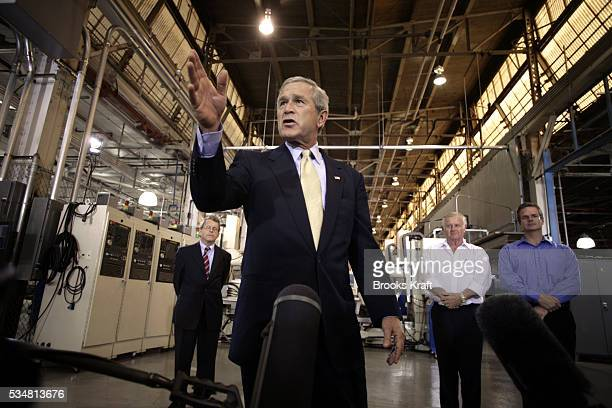 US President George W Bush and US Senator Mike DeWine visit Meyer Tool Inc in Cincinnati September 25 2006 Bush later attended a fundraiser for...