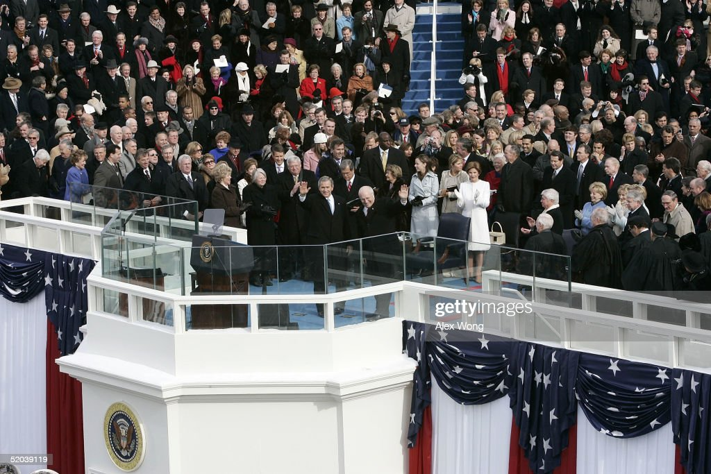 U.S. President George W. Bush (Center-L) and U.S. Vice President Dick Cheney (Center-R) wave after taking the oaths of office for their second terms during ceremonies on the west front of the U.S. Capitol January 20, 2005 in Washington, DC. In his address, President Bush outlined his plans to pursue freedom around the world as well as push a legacy-setting agenda at home championing 'freedom in all the world' as the surest path to peace.