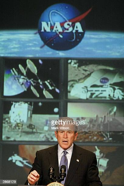 S President George W Bush announces plans for man to return to the moon and eventual manned mission to Mars at NASA Head Quarters January 14 2004 in...