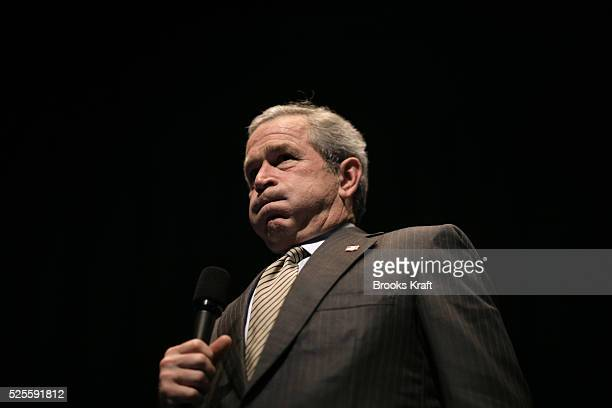 President George W Bush answers a question from members of the audience after delivering a speech on the war in Iraq at the Arie Crown Theatre in...