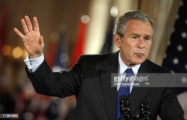 S President George W Bush answers questions during a joint press conference with Canadian Prime Minister Stephen Harper in the East Room July 6 2006...