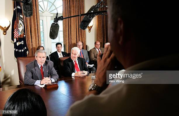 US President George W Bush answers questions from the media as Sen Richard Lugar looks on at the end of a meeting July 18 2006 at the Cabinet Room of...