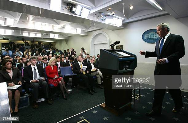 US President George W Bush arrives for a press conference in the Brady Briefing Room at the White House in Washington DC 17 October 2007 President...