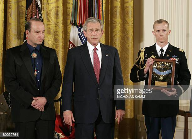 President George W. Bush attends a ceremony to present the Medal of Honor posthumously to US Army Master Sergent Woodrow Wilson Keeble, a hero of the...