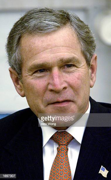S President George W Bush attends a meeting with the 'quartet' of Middle East peace mediators from Europe Russia and the UN December 20 2002 in the...