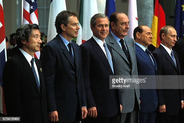 President George W. Bush attends the G8 Summit in Genoa, Italy with form the left Japanese Prime Minister Junichiro Koizumi, British Prime Minister...