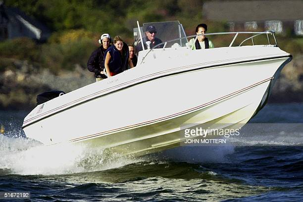 President George W Bush boats with his father former US president George Bush and other family members Doro Koch and Jenna Bush 05 October 2002 in...