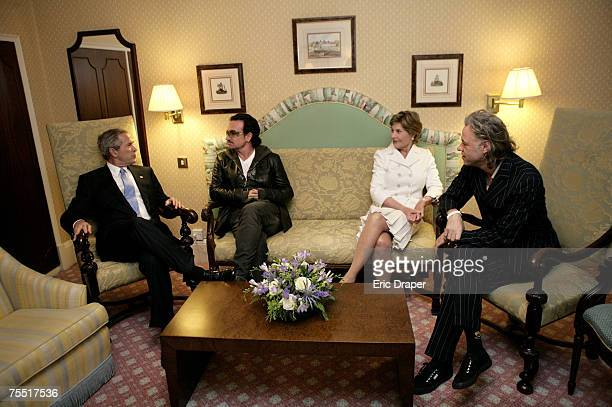President George W Bush Bono Laura Bush and Bob Geldof far right hold a working meeting on Africa at the G8 Summit in Gleneagles Scotland Wednesday...