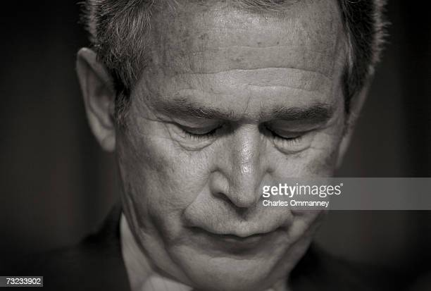 President George W Bush bows his head in prayer during the National Prayer Breakfast on February 1 2007 in Washington DC