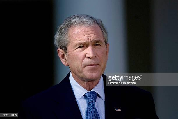 S President George W Bush Bush pauses while speaking in the Rose Garden of the White House October 10 2008 in Washington DC President Bush spoke...