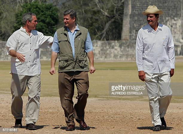 President George W. Bush , Canada's Prime Minister Stephen Harper and Mexican President Vicente Fox talk during a tour at the archeological area of...