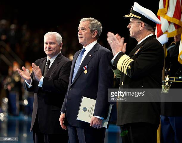 S President George W Bush center is applauded by Robert Gates secretary of defense left and Admiral Michael Mullens chairman of the Joint Chiefs of...