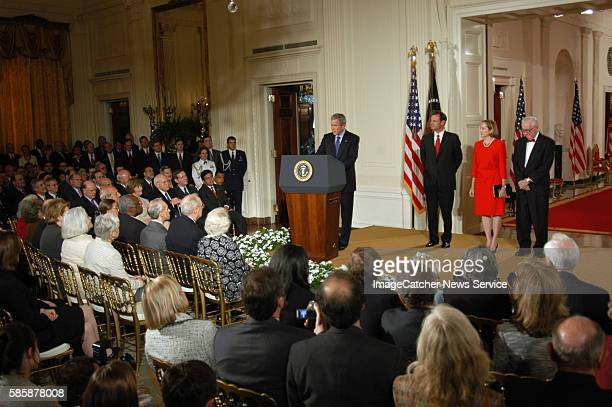 President George W. Bush, center, speaks before swearing in John Roberts as the 17th chief justice of the United States during a ceremony in the East...