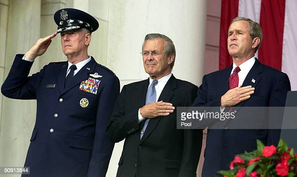 President George W. Bush , Chairman of the Joint Chiefs of Staff, General Richard B. Myers and U.S. Secretary of Defense Donald Rumsfeld watch the...