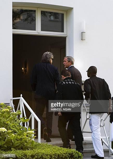 President George W Bush chats with Irish environmental activist and U2 lead singer Bono Irish political activist Bob Geldof and Senegalese musician...
