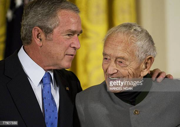 US President George W Bush chats with painter Andrew Wyeth after presenting him with the 2007 National Medal of Arts 15 November 2007 in the East...