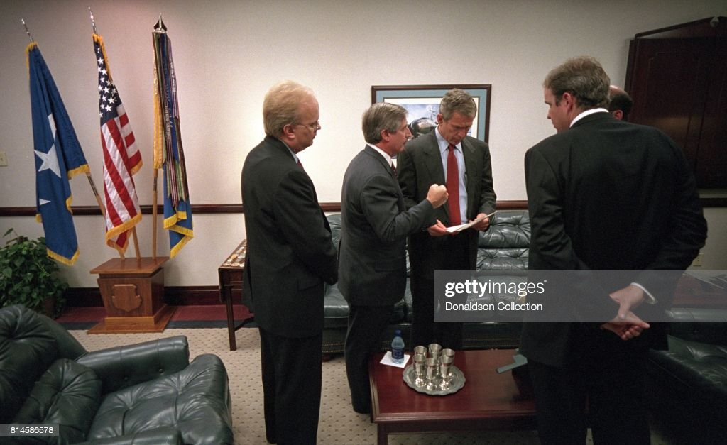 President George W. Bush confers with, from left, Karl Rove, Andy Card, Dan Bartlett and Ari Fleischer, Tuesday, Sept. 11, 2001, prior to delivering remarks on the World Trade Center disaster from the General Dougherty Conference Center at Barksdale Air Force Base in Louisiana. Photo by Eric Draper, Courtesy of the George W. Bush Presidential Library/Getty Images