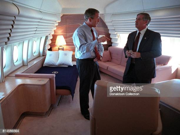 President George W Bush confers with White House Chief of Staff Andy Card Tuesday Sept 11 in the President's stateroom aboard Air Force One Photo by...