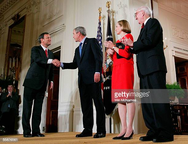 S President George W Bush congratulates Chief Justice of the United States Supreme Court John Roberts after being sworn in as Associate Justice John...