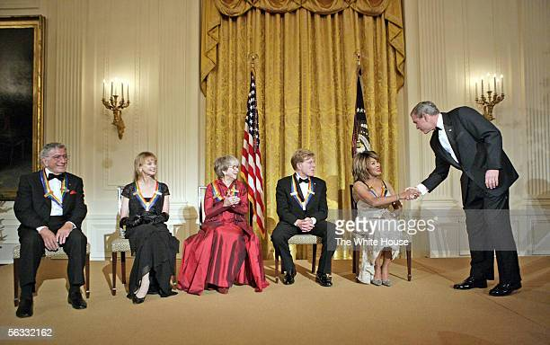 S President George W Bush congratulates singer Tina Turner during a reception for the Kennedy Center Honors in the East Room of the White House as...