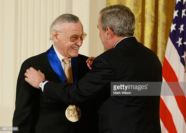 S President George W Bush congratulates Stan Lee founder of POW Entertainment after presenting him with the 2008 National Medals of Arts award during...